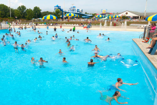 people swimming in a wave pool