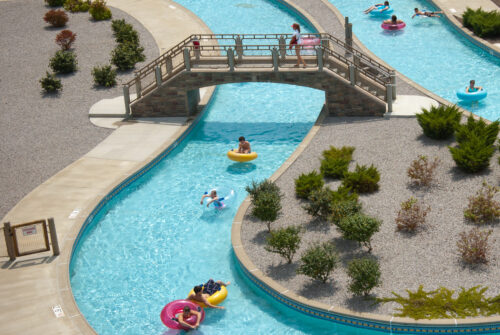 people floating on tubes down lazy river at waterpark
