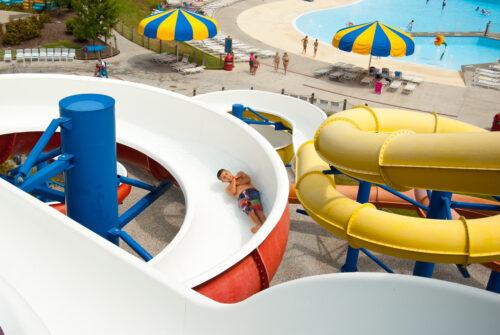 boy sliding on waterpark body slide