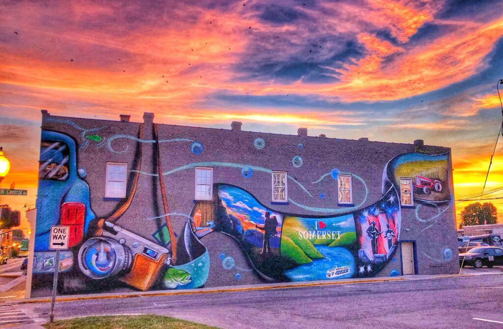 mural on side of building at sunset